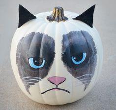 grumpy cat pumpkin.. It's my sister in law on a pumpkin lmao omg stop it