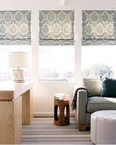 How to create drama with Roman shades in a family room: hang multiples in a row for a seamless look.