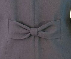 1950s suit with bow