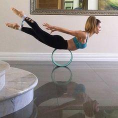 salabhasana on wheel | yoga