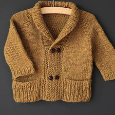 Comfortable yet elegant, comfortable and warm, this is the perfect cardigan to cuddle up in . Cozy and yet elegant, comfortable and warm - this is the perfect cardigan to nestle into the story. Just ribbed enough to be distinguished . and jus. Baby Cardigan, Baby Pullover, Baby Boy Knitting, Knitting For Kids, Baby Knitting Patterns, Knitting For Charity, Knit In The Round, Garter Stitch, Baby Sweaters