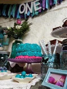 Green-Eyed Girl Productions: A First Birthday Party with a Vintage Twist.... Rustic Lace, Blue Mason Jars, Purple & Fuchsia First Little Girl's themed party. Fabric ONE Banner, milk glass. Teal Cake