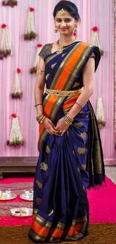 Parnicaa Reddy in a Beautiful Navy Blue Silk Saree with Elephant Bhuttas and Contrasting Orange Border