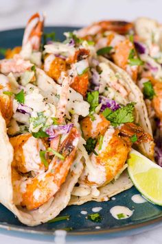 Make a weeknight meal or last minute entertainment a breeze with Easy Shrimp Tacos. A spicy, creamy and healthy recipe with cabbage slaw!