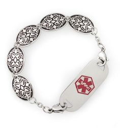 """Venus Medical ID Bracelet. You're a goddess of love and strength. Each stainless steel oval link measures .75"""" by .5"""" and features a unique, heart-like Celtic pattern. This entirely stainless steel piece combines durability with style for a look that is both flexible and just plain gorgeous. Simply attach to your custom engraved medical ID tag with our signature lobster clasps to complete the look. #laurenshopeID #medicalID $54.95"""