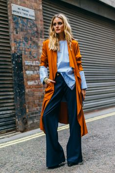 Striped blouse, wide leg trousers, burnt orange trench.
