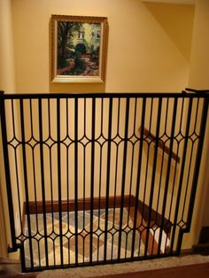indoor metal dog gate between mud room area  and hallway into the rest of the house