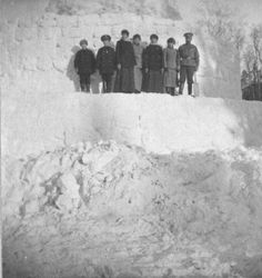 Kolya Derevenko, Tsarevich Alexei, Grand Duchesses Tatiana, Maria, Olga and Anastasia, and Nicholas II on top of a snow tower constructed in the park at Tsarskoe Selo in February of 1916.