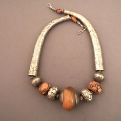 Nepal | Necklace; silver, beautiful old coral, and an amber bead obviously millions of years old | Found in the Kathmandu area; dates from the first half of the 20th century | 850€