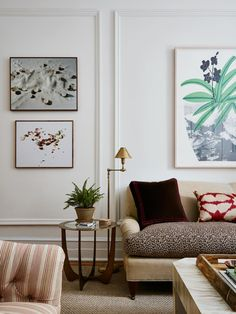 an eclectic mix of modern art and formal furnishings in this small apartment living room | room of the week via coco kelley