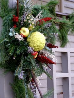 Garland decoration at Colonial Williamsburg.  The pineapple and hedgeapple combination is so unique!
