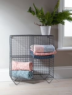 Stylish and practical, our wire shelf unit has four shelves and handy keyholes to secure it to your wall. The wire mesh frame lends a touch of industrial style to your office, lounge or bathroom - pair with our Wire Shelf Rack to intensify the look, or surround with soft furnishings to add femininity.