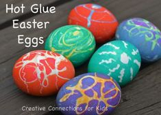 Make a design with hot glue on eggs, dip into dye, and when cool peel of the glue.