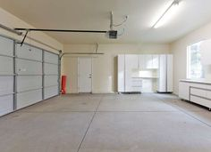 Concrete slabs usually crack or flake over time, and a few hairline cracks in a garage floor aren't ... - istockphoto.com