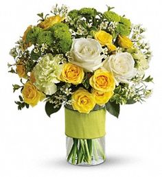 TEV11-1A  This charming bouquet includes white roses, yellow spray roses, green carnations, green button spray chrysanthemums and white waxflower accented with assorted greenery. Delivered in a glass cylinder vase.