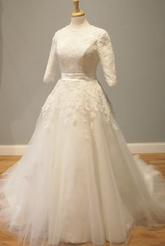 Natsuko's Long Sleeve Wedding Dress - Avail & Company, LLC A beautiful lace modest wedding dress, with fairy tale vintage style. Perfect for a country, spring, fall, pastel, winter or christmas wedding. Made from gorgeous poofy tulle!