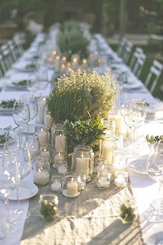 Those wanting to add candles to an all-white tablescape need look no further than simple glass jars to make a subtle statement. Use them in varying sizes and shapes to add dimension to your decor.