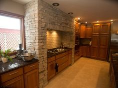 Colonial Tan™ Ledgestone Thin Veneer is a natural stone that consists of radiant browns, beige, tan, and light gray accentuated by gold and silver specks. Thin Stone Veneer, Building Stone, Stone Columns, Stone Work, Colonial, Kitchen Cabinets, Architecture, Home Decor, Products