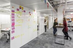 #collaborative #whiteboard - The open plan office areas feature sliding screens and write-on-walls