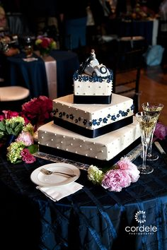 Car wedding cake topper, Square wedding cake Blue and white wedding cake. I would change the topper.