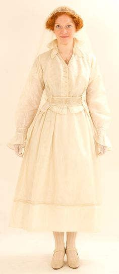 WW1 wedding dress - c. 1916. Silk taffeta with cording, pleated ruffles and bead embroidery. Modelled for Fashion: Women in World War One book. History Wardrobe collection