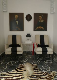 circles on the floor & stripes on chairs + portraits | via HIs-and-Hers Design ~ Cityhaüs Design