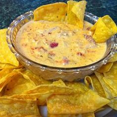 Outrageous Warm Chicken Nacho Dip from Allrecipes.com...made in the crockpot...a serious crowd-pleaser that is served hot as a dip, spooned over crisp tortilla chips nacho-style, or rolled up in a warm flour tortilla