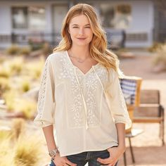 "ELISA LACE TUNIC -- Our all-cotton tunic is so feminine, with lovely, lace insets at front and back yoke and sleeves. Notch neckline and ties. Hi-lo hem. Machine wash. Imported. Exclusive. Sizes XS (2), S (4 to 6), M (8 to 10), L (12 to 14), XL (16). Front approx. 25""L."