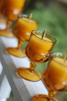 Beeswax candles in vintage glasses