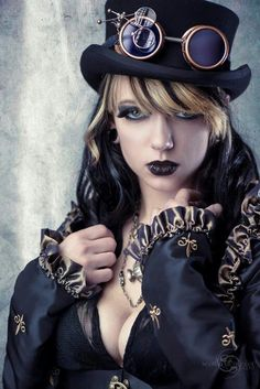 Steampunk gothic. I would go with a deep red on the lips and put the girls away. But if you've got flaunt it!