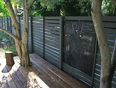 Place a chalkboard on your fence to keep kids entertained in the sunshine!