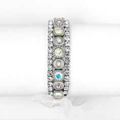 This gorgeous and elegant vintage inspired 3/4'' w bracelet with AB crystals and 2 lovely rows of crystal rhinestones makes it the perfect accessory for your special night.