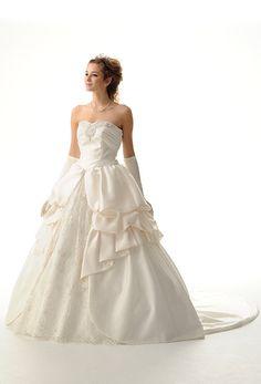 """Achen"" strapless white wedding dress from Royal Wedding by Takami Bridal."