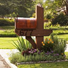 Because most mailboxes are right up against the street, plants need to be extra tough. Look for varieties that can hold up to summer heat and, if you live in an area that sees much snow, winter salt. Here, drought-tolerant sedum, showy California poppy, iris, fragrant rosemary, and yellow coreopsis mix with colorful purple petunias and verbena. Learn more about growing petunias. Learn more about growing verbena./