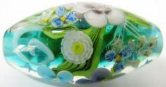 Handmade lampwork bead by Johan de Lange, white flower murrini by Sandra Schenck