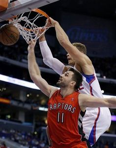 Los Angeles Clippers' Blake Griffin, top, dunks over Toronto Raptors' Linas Kleiza