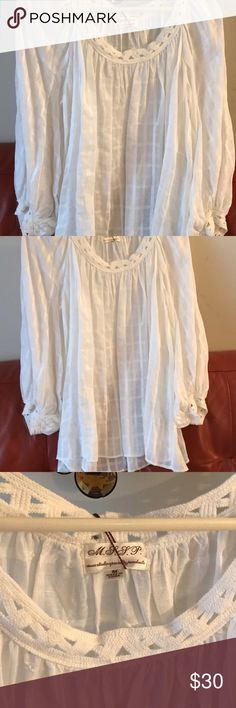 Size medium Blouse- stylish, white and flowy. It has never been worn. It still has the tags attached. It's white, stylish, and flowy. In my opinion it's too transparent to be worn alone and would need some type of under garment. I think it could be dressed up or down. I love this look with some denim jeans. max studio speciality products Tops Blouses