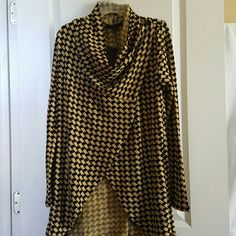 Convertible Cardigan This black and tan convertible cardigan can be worth opened or wrapped as shown!!! I also have an all black available. Comment if interested ☺ The Limited Sweaters