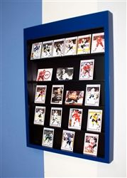 A wall display for your card collection.  Holds up to 30 of your favorite cards!  Inside: Black  Outside: Blue    Collector Card Display for your kids room, game room or garage. Sport Interiors creates high quality sports sport furniture and accessories. We can customize our products with your team's favorite colors! Made in the U.S.A.