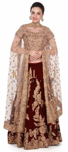Buy this Maroon lehenga adorn in zari and kundan work all over only on Kalki