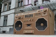 Artist Bartek Elsner designed and constructed a 10-foot boom box out of cardboard to highlight the Mini Cooper's powerful sound system. in Zurich, Switzerland.