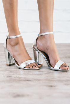 Put the focus on your feet this summer in these on-trend sandals! The gorgeous, metallic silver complements every skin tone and works perfectly with everything from maxi dresses to shorts. The ankle strap and block heel make them easy to wear and keep you comfortable all night long. They're runway-ready and so perfect that you'll never want to take them off. Heel is 2.5 inches. All man made materials. Fit true to size.