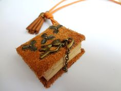 Nice mini-book necklace with leather cover by swiesele on Etsy