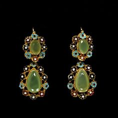 Ca. 1825, France. Enamelled gold with Chrysoprases. Gold, in a variety of treatments, became a dominant element in jewellery from the 1820s. It was used successfully in mesh necklaces and bracelets, gold chain and wire work, also as a foil to gemstones.    The technique of filigree with spirals and granules (cannetille and grainti) was revived in France then copied in England. Jewellers liked the economical use of gold and women appreciated the intricacy of the style.