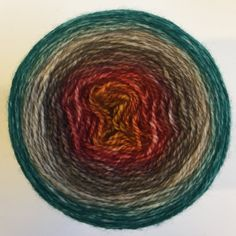 Nantahala - Fifty Shades of Gradient™ From gold to orange, red, brown, green and blue - beautiful color stripes. #shawlyarn #gradient #selfstriping #cake