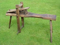 Shave horse in solid oak with turned front leg in ash. Excellent condition even though about 20 years old. Two sizes of wedges for varying the slope of the table.