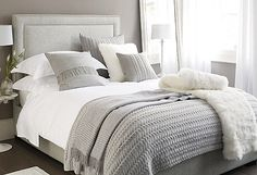 I like the grey throws and pillows on the white bed cover