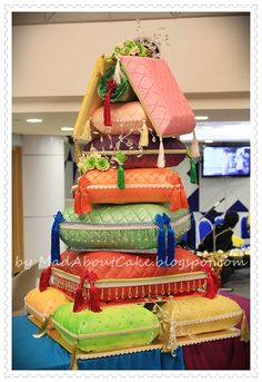 Rick Reichart, who co-owns cakelava with his wife, Sasha, designed this colorful sculpted-pillow wedding cake with handcrafted accent pieces for a yoga instructor's tropical wedding. Description from pinterest.com. I searched for this on bing.com/images