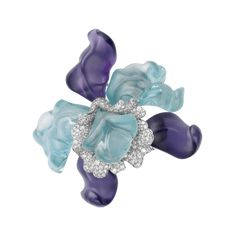 CARTIER - Caresse D'Orchidée  Brooch from the Flora & Fauna Collection. White Gold, 3 sculpted Aquamarine petals, 3 sculpted Amethyst petals, Brilliants. The orchid, Queensland of the Cartier garden, carved in Amethyst and Aquamarine, expresses all its grace and evokes delicate femininity. This exceptional piece is an example of truly rare expertise, requiring several hundred hours of unique craftsmanship.