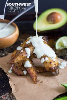 Crispy oven-baked chicken wings marinated in homemade Southwest Seasoning Mix are a great addition to any party! Serve with an Avocado Salsa Verde sauce to cool them down! Southwest Chicken Wings Recipe | Take Two Tapas
